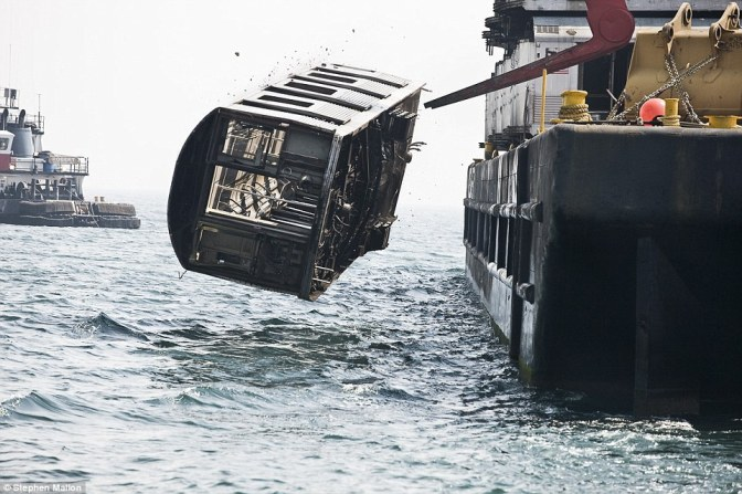 Why have 2,500 New York subway cars been dumped in the sea?