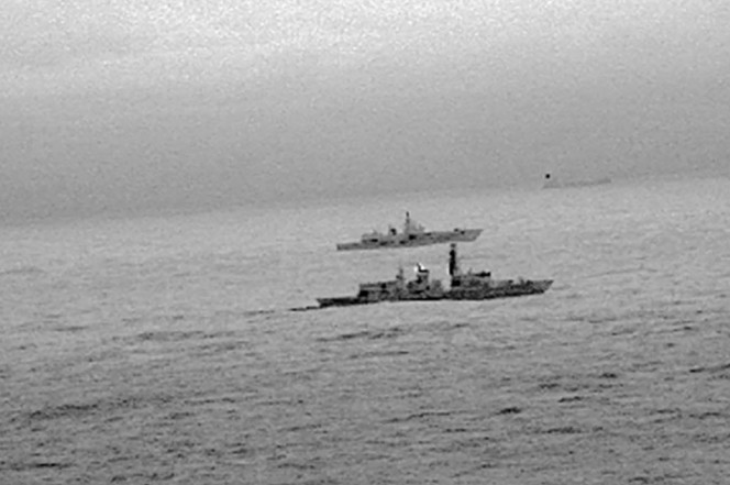 Britain's Royal Navy frigate HMS St Albans escorts a Russian warship through the North Sea